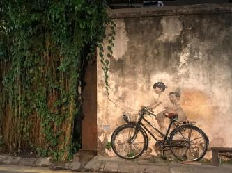 Going to see the street art at night can be charming and less crowded...
